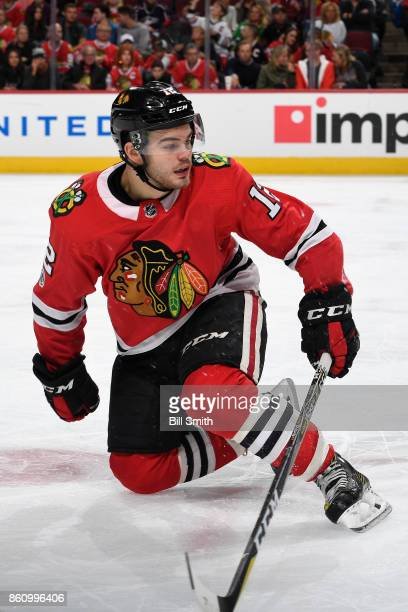 Alex DeBrincat of the Chicago Blackhawks watches for the puck during the game against the Columbus Blue Jackets at the United Center on October 7...