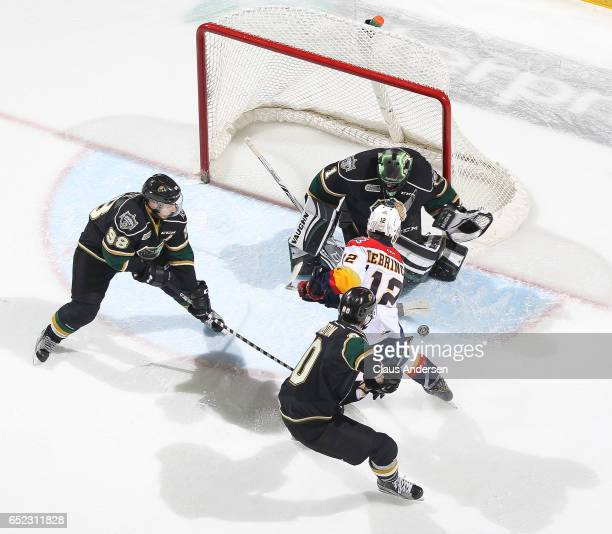 Alex DeBrincat of the Erie Otters is stopped by Tyler Parsons of the London Knights during an OHL game at Budweiser Gardens on March 10 2017 in...