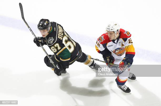 Alex DeBrincat of the Erie Otters skates against Mitchell Stephens of the London Knights during an OHL game at Budweiser Gardens on March 10 2017 in...
