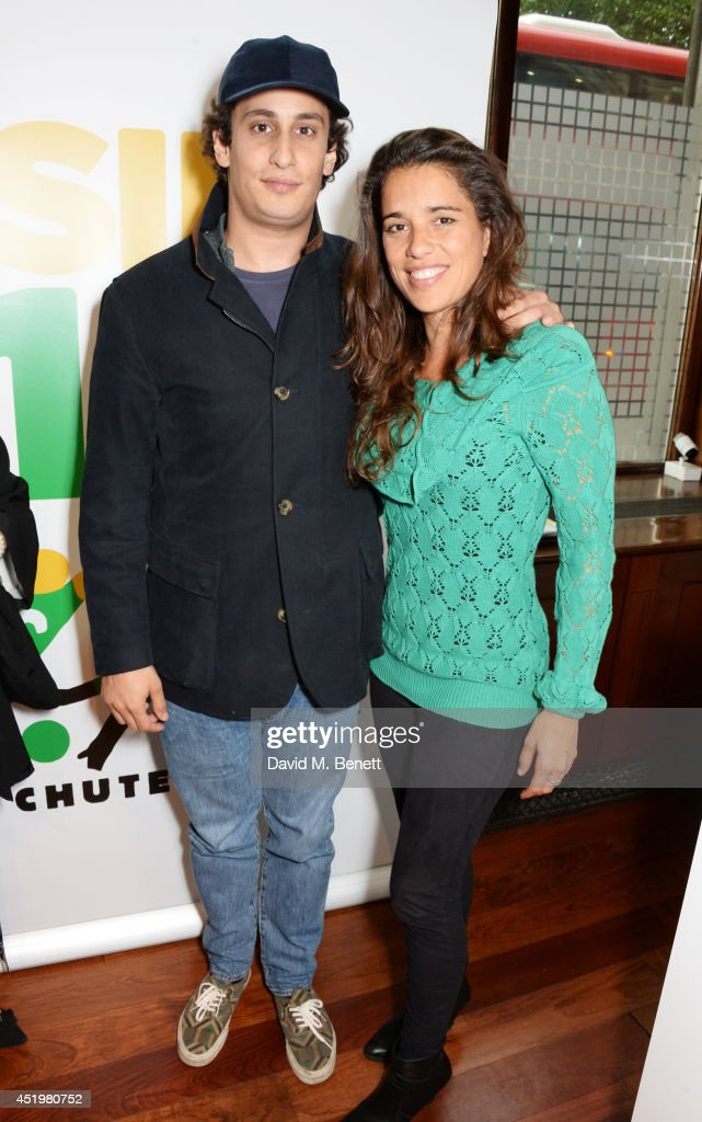 <a gi-track='captionPersonalityLinkClicked' href=/galleries/search?phrase=Alex+Dellal&family=editorial&specificpeople=724081 ng-click='$event.stopPropagation()'>Alex Dellal</a> (L) and Jimena Paratcha, Founding Trustee of ABC TRUST, attend 'The Art Of Futebol' charity auction in support of Action for Brazil's Children Trust at the Embassy of Brazil on July 10, 2014 in London, England.