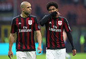Alex Dias da Costa and Luiz Adriano of AC Milan show their dejection at the end of the Serie A match between AC Milan and Bologna FC at Stadio...