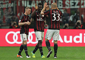 Alex Dias da Costa of AC Milan celebrates with his teammates Mario Balotelli and Ignazio Abate after scoring the opening goal during the Serie A...