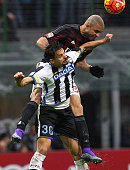 Alex Dias da Costa of AC Milan competes for the ball with Felipe Dal Belo of Udinese Calcio during the Serie A match between AC Milan and Udinese...