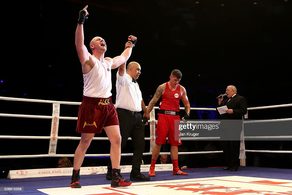 Alex Dickinson(L) celebratres the win over Chezerae Nihell in their over 91kg final bout during day three of the Boxing Elite National Championships at Echo Arena on May 01, 2016 in Liverpool, England.