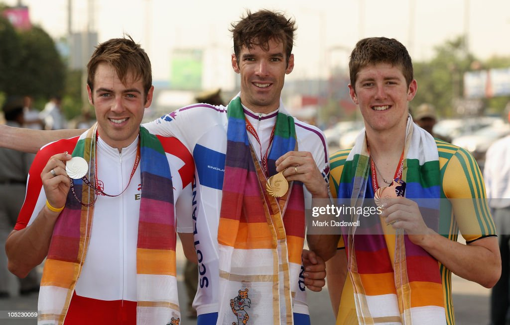 Alex Dowsett of England silver, David Millar of Scotland gold and Luke Durbridge of Australia bronze, celebrate with their medals after the Mens Individual Time Trial during day ten of the Delhi 2010 Commonwealth Games on October 13, 2010 in Delhi, India.
