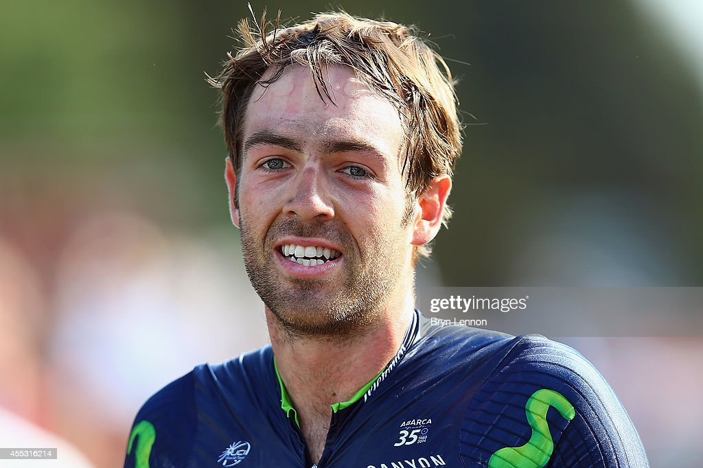 Alex Dowsett of Great Britain and Movistar watches the TV to check if he has taken the race lead after stage six of the Tour of Britain from Bath to Hemel Hempstead on September 12, 2014 in Hemel Hempstead, England.