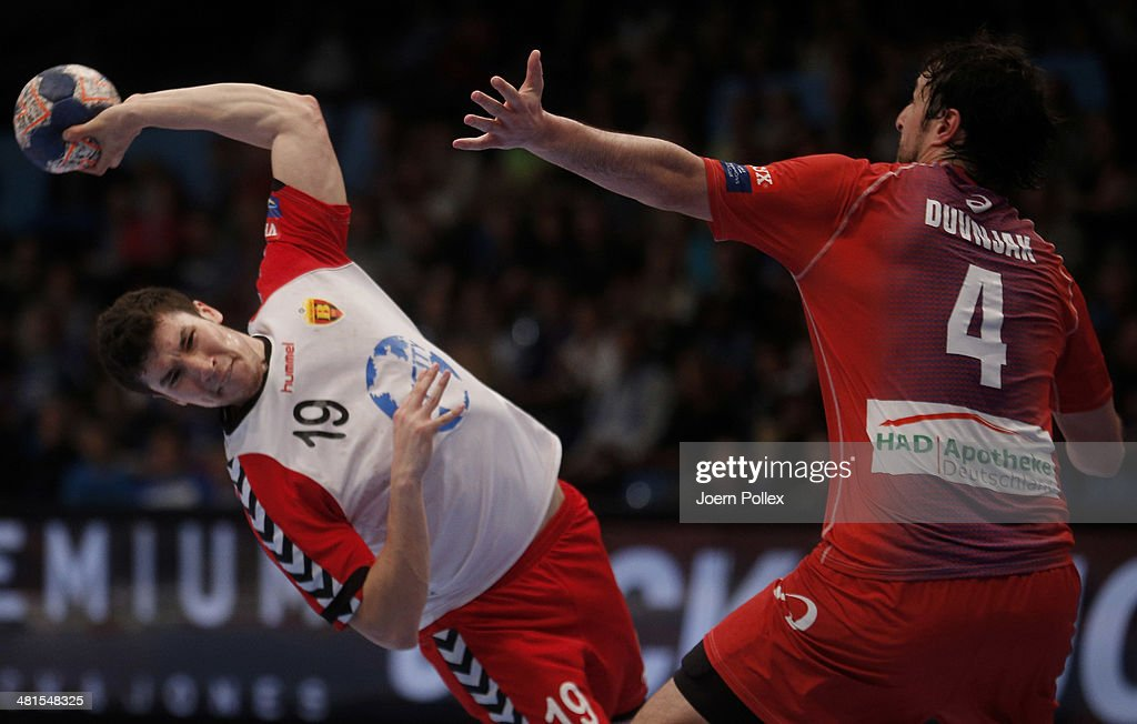 Alex Dujshebaev of Skopje scores during the Velux EHF Champions League Round of 16 2nd leg match between HSV Hamburg and HC Vardar Pro Skopje at O2 World on March 30, 2014 in Hamburg, Germany.