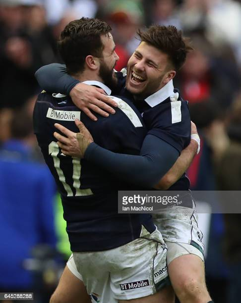 Alex Dunbar and Ali Price celebrates at full time during the 6 Nations match between Scotland and Wales at Murrayfield Stadium on February 25 2017 in...