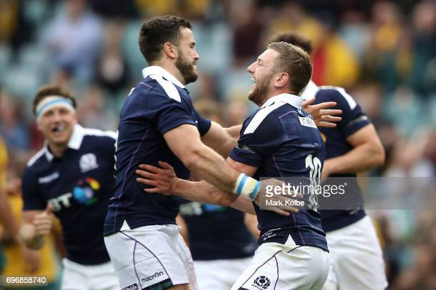 Alex Dunbar and Finn Russell of Scotland celebrate Russell scoring a try during the International Test match between the Australian Wallabies and...