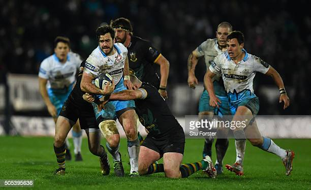 Alex Dunbar of Glasgow Warriors is hauled down by the Northampton defence during the European Rugby Champions Cup pool three match between...