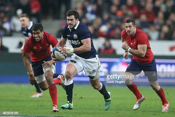 Alex Dunbar of Scotland breaks with the ball during the RBS Six Nations match between France and Scotland at Stade de France on February 7 2015 in...