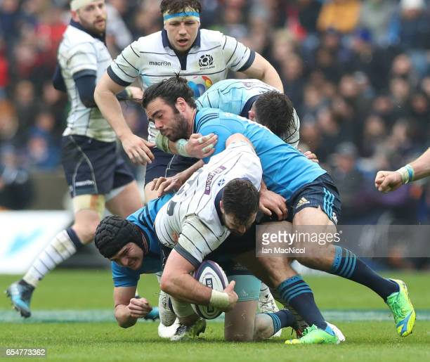 Alex Dunbar of Scotland is tackled by Carlo Canna and Luke McLean of Italy during the RBS Six Nations match between Scotland and Italy at Murrayfield...