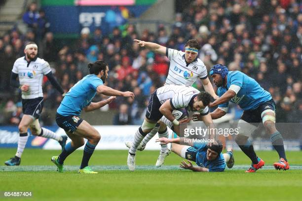 Alex Dunbar of Scotland is tackled by Carlo Canna of Italy during the RBS Six Nations Championship match between Scotland and Italy at Murrayfield...