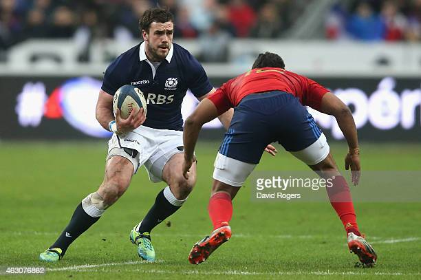 Alex Dunbar of Scotland runs with the ball during the RBS Six Nations match between France and Scotland at Stade de France on February 7 2015 in...