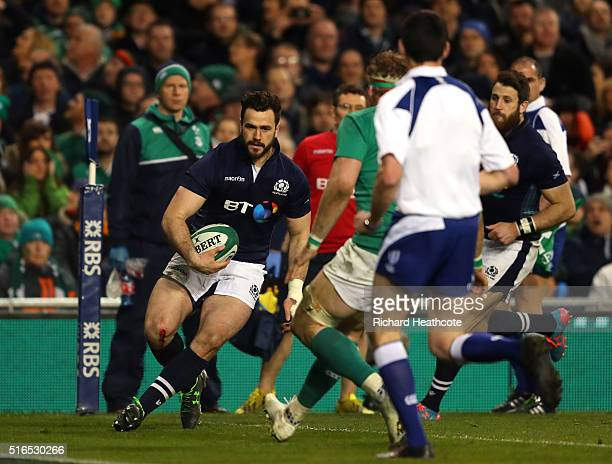 Alex Dunbar of Scotland scores a late consolation try during the RBS Six Nations match between Ireland and Scotland at the Aviva Stadium on March 19...