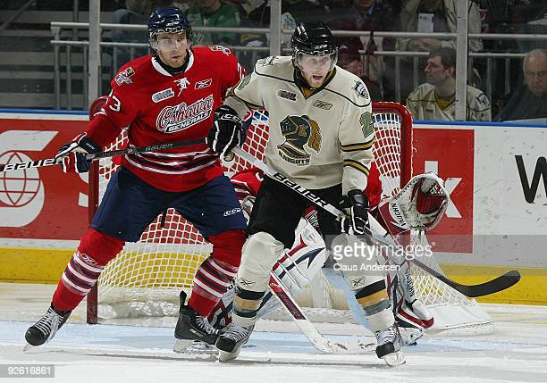 Alex Dzielski of the Oshawa Generals holds Colin Martin of the London Knights in check in a game on October 30 2009 at the John Labatt Centre in...