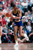 Alex English of the Denver Nuggets passes against the Portland Trail Blazers during a game played in 1986 at the Veterans Memorial Coliseum in...