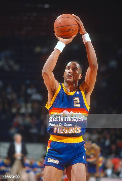 Alex English of the Denver Nuggets shoots a free throw against the Washington Bullets during an NBA basketball game circa 1990 at the Capital Centre...