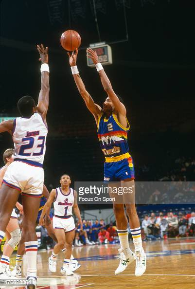 Alex English of the Denver Nuggets shoots over Charles Jones of the Washington Bullets during an NBA basketball game circa 1988 at the Capital Centre...