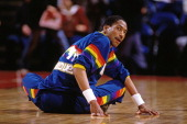 Alex English of the Denver Nuggets stretches against the Portland Trail Blazers during a game played circa 1986 at the Veterans Memorial Coliseum in...