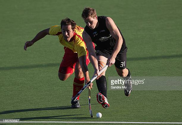 Alex Fabregas of Spain and Steven Edwards of New Zealand in action during the match between New Zealand and Spain on day four of the 2011 Men's...