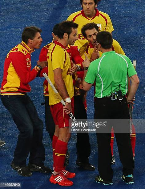 Alex Fabregas of Spain gestures towards match referee John Wright of South Africa at the conclusion of the match during the Men's Hockey match...