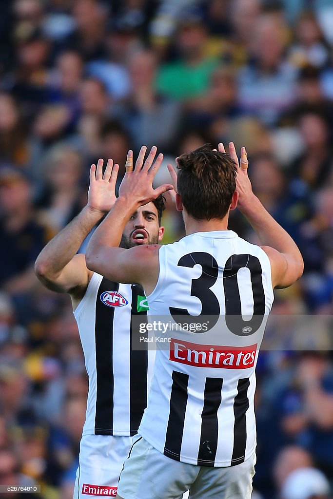 Alex Fasolo and Darcy Moore of the Magpies celebrate a goal during the round six AFL match between the West Coast Eagles and the Collingwood Magpies at Domain Stadium on May 1, 2016 in Perth, Australia.
