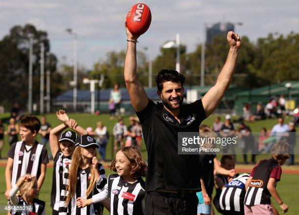 Alex Fasolo celebrates during a Collingwood Magpies School Holiday AFL clinic at Olympic Park on April 14 2014 in Melbourne Australia