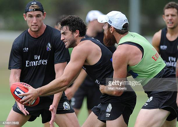 Alex Fasolo handballs in the tackle during a Collingwood Magpies AFL training session at the Southport Football Club on February 26 2014 on the Gold...