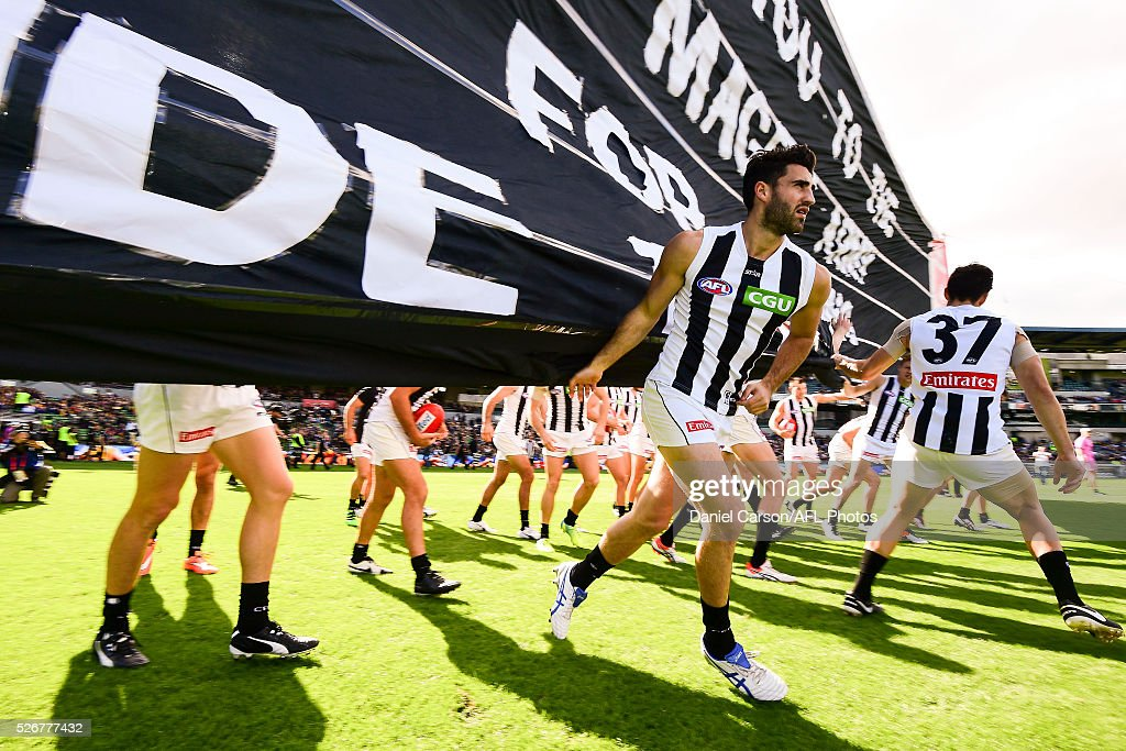 Alex Fasolo of the Magpies breaks the banner during the 2016 AFL Round 06 match between the West Coast Eagles and the Collingwood Magpies at Domain Stadium, Perth on May 1, 2016.