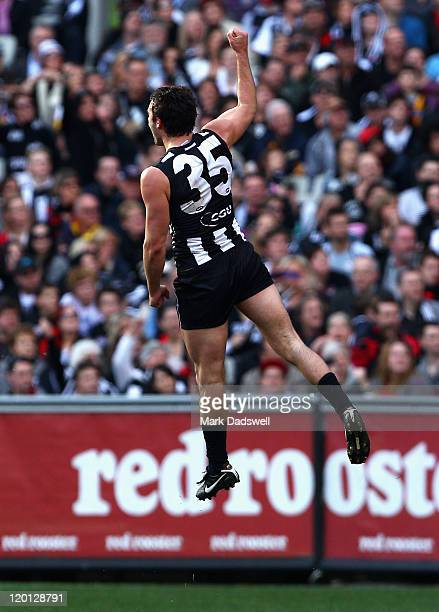 Alex Fasolo of the Magpies celebrates a goal during the round 19 AFL match between the Collingwood Magpies and the Essendon Bombers at Melbourne...