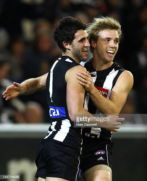 Alex Fasolo of the Magpies celebrates a goal with Ben Sinclair during the round eight AFL match between the Collingwood Magpies and the Geelong Cats...