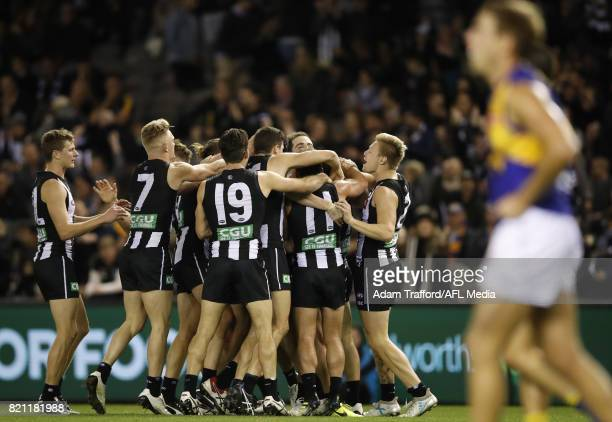 Alex Fasolo of the Magpies celebrates a late goal to seal the match with teammates during the 2017 AFL round 18 match between the Collingwood Magpies...