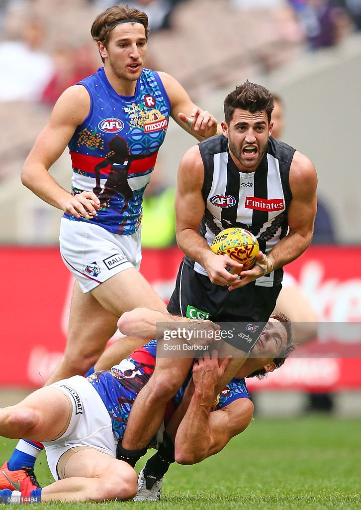 Alex Fasolo of the Magpies is tackled during the round 10 AFL match between the Collingwood Magpies and the Western Bulldogs at Melbourne Cricket Ground on May 29, 2016 in Melbourne, Australia.