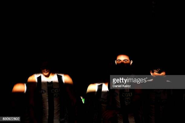 Alex Fasolo of the Magpies leads his team mates onto the ground prior to the round 21 AFL match between Port Adelaide Power and the Collingwood...