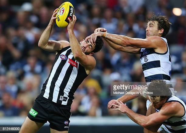 Alex Fasolo of the Magpies marks the ball against Corey Enright and Jed Bews during the 2016 NAB Challenge match between the Geelong Cats and the...
