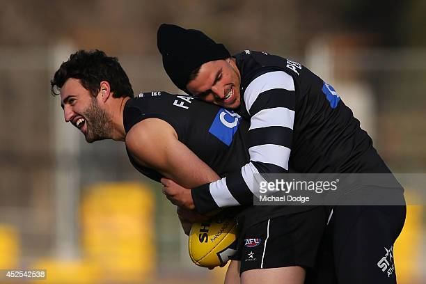 Alex Fasolo reacts after being tackled by Scott Pendlebury of the Magpies during a Collingwood Magpies AFL training session at Westpac Centre on July...