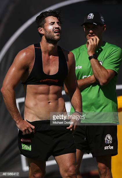 Alex Fasolo reacts after running a lap during a Collingwood Magpies AFL training session at Olympic Park on January 23 2015 in Melbourne Australia