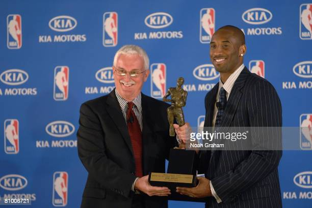 Alex Fedorak of Kia Motors presents Kobe Bryant of the Los Angeles Lakers with the MVP award during a press conference for the 200708 NBA Most...