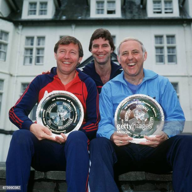 Alex Ferguson Manager Aberdeen FC Martin Buchan Jim McLean Manager Dundee United after being presented with the Promotion and Teaching of Football...