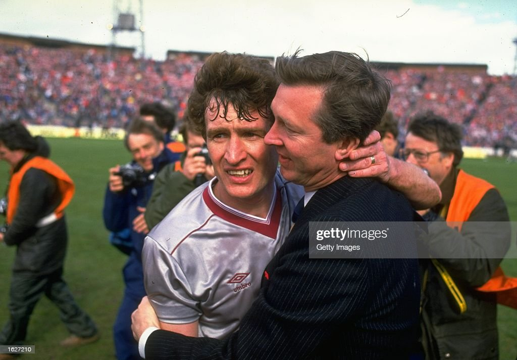 Alex Ferguson (right) Manager of Aberdeen hugs Sandy Jardine (left) of Hearts in commiseration after the Scottish Cup Final match at Hampden Park in Glasgow, Scotland. Aberdeen won the match 3-0. \ Mandatory Credit: Allsport UK /Allsport