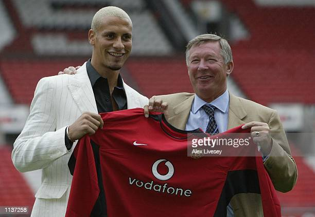 Alex Ferguson the manager of Manchester United shares a laugh with new signing Rio Ferdinand at a press conference at Old Trafford Manchester England...