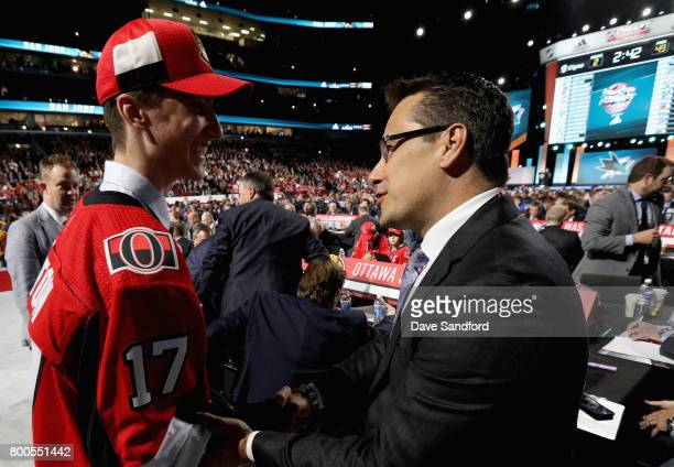 Alex Formenton greets head coach Guy Boucher after being selected 47th overall by the Ottawa Senators during the 2017 NHL Draft at United Center on...