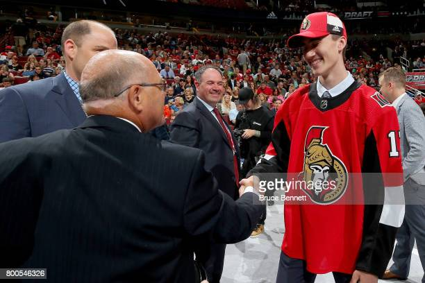 Alex Formenton meets with executives after being selected 47th overall by the Ottawa Senators during the 2017 NHL Draft at the United Center on June...