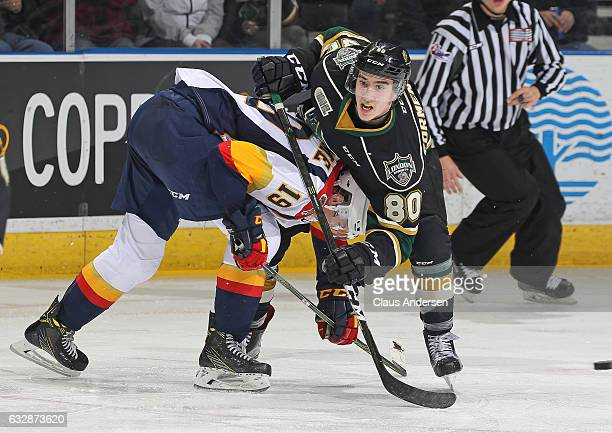 Alex Formenton of the London Knights battles against Dylan Strome of the Erie Otters during an OHL game at Budweiser Gardens on January 27 2017 in...