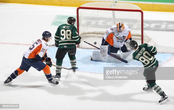 Alex Formenton of the London Knights fires a shot past Connor Hicks of the Flint Firebirds during an OHL game at Budweiser Gardens on March 17 2017...