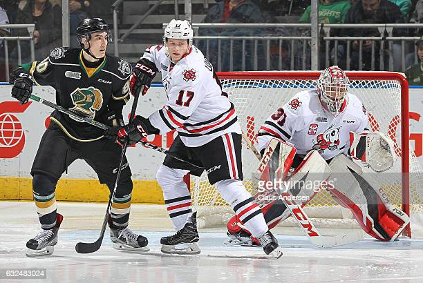 Alex Formenton of the London Knights is held in check by William Lochead of the Niagara IceDogs during an OHL game at Budweiser Gardens on January 22...