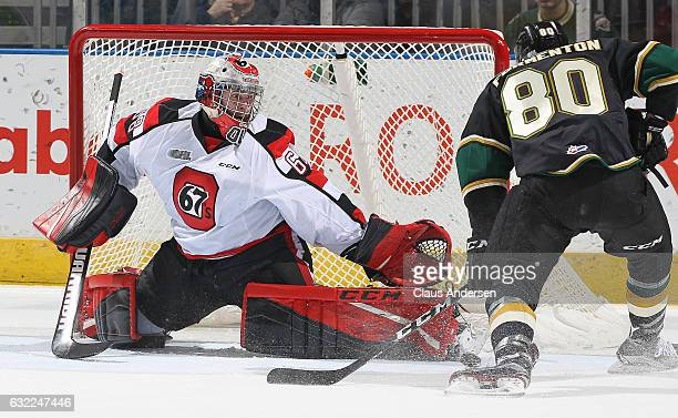 Alex Formenton of the London Knights is stopped by Olivier Lafreniere of the Ottawa 67's during an OHL game at Budweiser Gardens on January 20 2017...