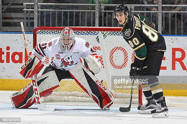 Alex Formenton of the London Knights looks for a shot to tip at Colton Incze of the Niagara IceDogs during an OHL game at Budweiser Gardens on...