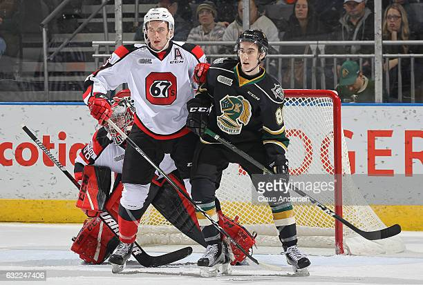 Alex Formenton of the London Knights skates against Ryan Orban of the Ottawa 67's during an OHL game at Budweiser Gardens on January 20 2017 in...
